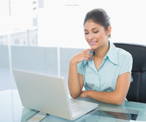 Business Woman at Laptop, Payroll Solutions in Lake City, FL and Gainesville, FL