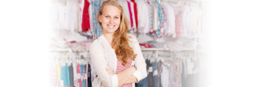 Female owner of clothes shop smiling,