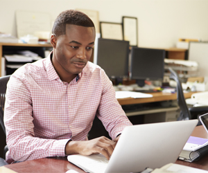 Businessman working on computer, Tax Preparation and Planning inLake City, FL and Gainesville, FL