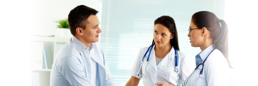Two female medical professionals speaking with male patient, QuickBooks and bookkeeping Medical and Health Care in Lake City, FL and Gainesville, FL